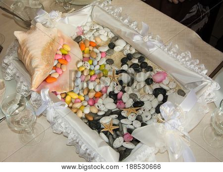 Colorful Wedding bonbons on a platter .