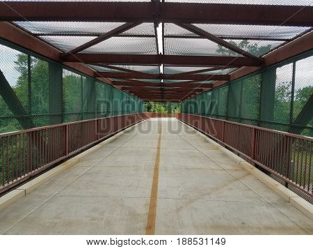 bike and walking path with red metal railing
