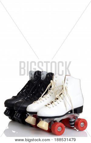 black and white quad roller skates on white background