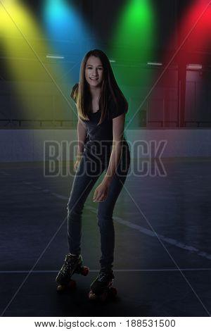 teen girl at roller skating rink disco dancing