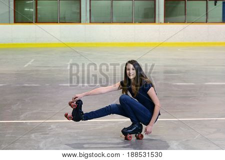 teen girl shoot the duck roller skating move