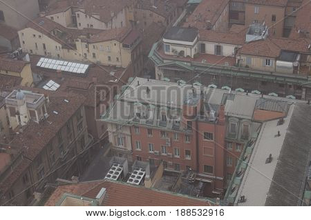 Typical buildings of Bologna. View from a narrow window with iron grid of Asinelli Tower. Emilia Romagna Italy.