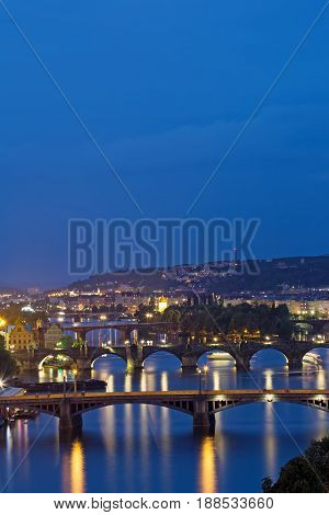 Prague at twilight blue hor view of Bridges on Vltava