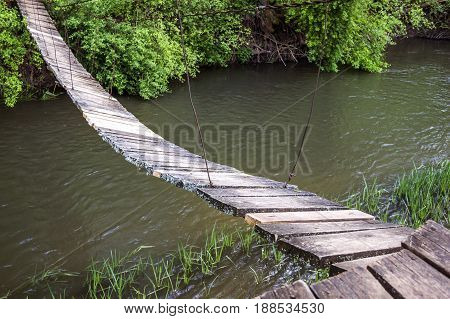 small suspension footbridge through the Strypa river Ternopil region of western Ukraine