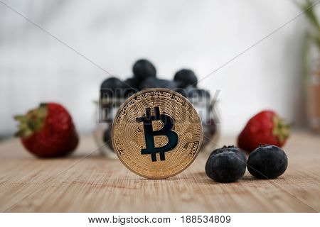 Gold Bitcoin Coin And Fruits