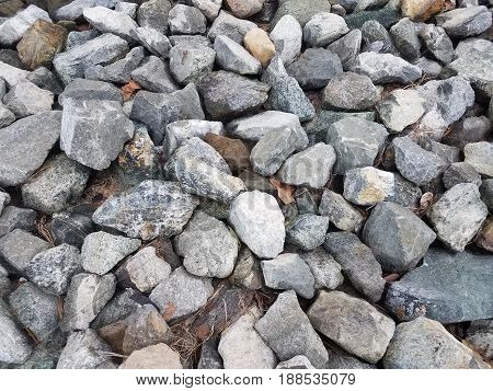 large grey and white stones on the ground