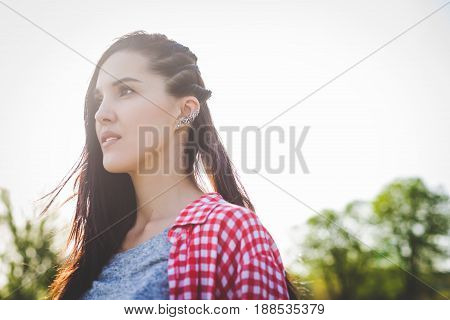 close-up portrait of cute hipster girl outdoors. looking in the distance. concept of freedom purposeful teenager