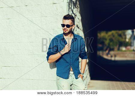 Portrait of a handsome man fashion model in urban background
