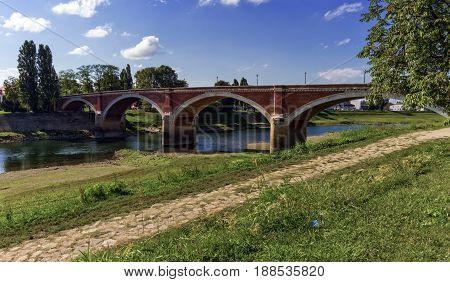 Old bridge over the Kupa river in Sisak by day, Croatia