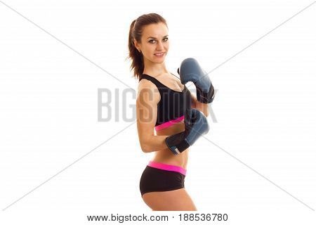 beautiful sports girl in boxing gloves looking at the camera isolated on white background