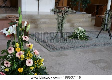 Baptismal Celebration Inside A Christian Church With Flowers