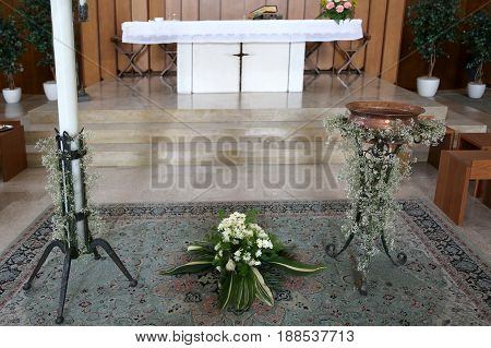 Altar Of The Christian Church With The Baptismal Font During The