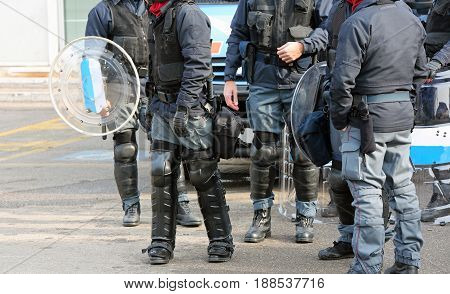Group Of Anti-riot Police Officers With Bullets And Protective Shields During Security Checks