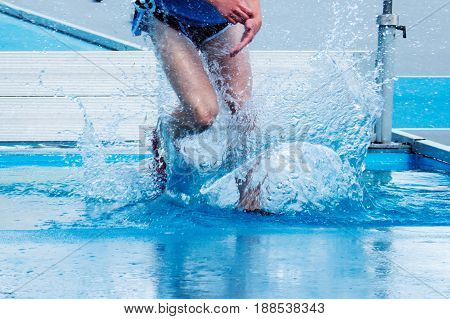 Landing ackwardly in the water pit during a steeplechase race