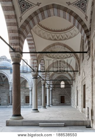 Passage leading to Sulaymaniye mosque a public Ottoman Baroque style mosque with columns arches and marble floor Fatih district Istanbul Turkey