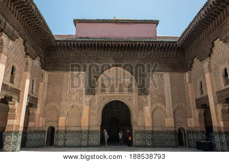 Marrakesh, Morocco - May 3, 2017: Tourists in inner courtyard of Medersa of Ben Youssef MarrakechMorocco