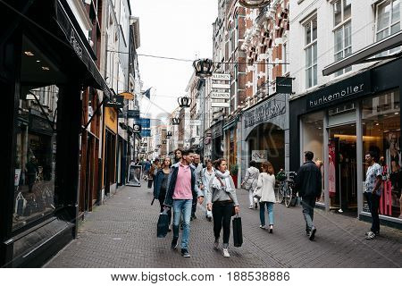 The Hague The Netherlands - August 7 2016: Unidentified people in Hoogstraat a commercial street in the city centre of the Hague. The Hague is the seat of the Dutch government and multiple international organizations.