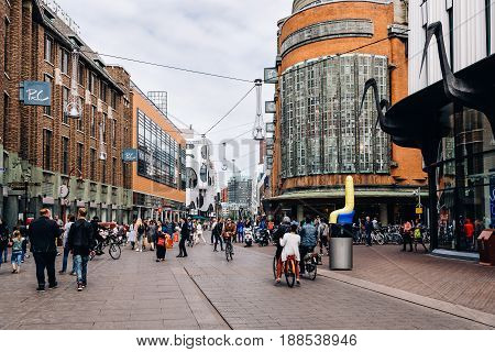 The Hague The Netherlands - August 7 2016: Unidentified people in Grote Marktstraat a commercial street in the city centre of the Hague. The Hague is the seat of the Dutch government and multiple international organizations.