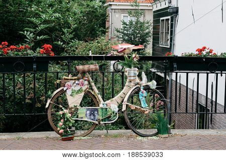 Monnickendam Netherlands - August 08 2016. Bicycle decorated with flowers in the dutch village of Monnickendam. The town was founded by monks and it is a small fishing village today