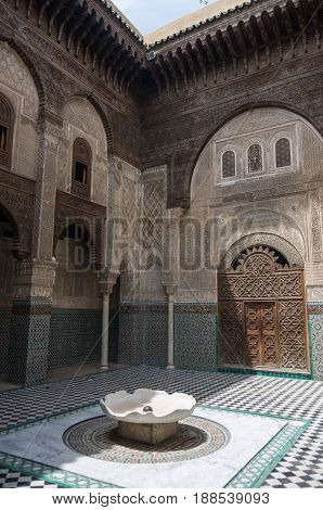 Fez, Morocco - May 9, 2017: Courtyard of Al-Attarine Madrasa is a madrasa in Fez medina in Morocco near the Al-Qarawiyyin Fez Mosque
