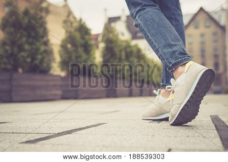 Legs And Feet. Young Girl Walking In The City