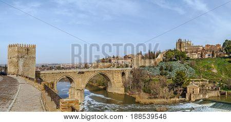Panoramic view of Monastery of San Juan de los Reyes (Monastery of Saint John of the Monarchs) with st. Martin bridge over Tagus river Toledo Spain