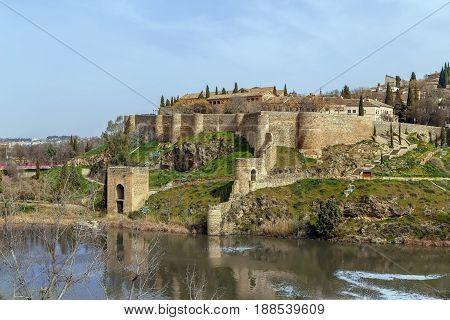 Wall and tower in Toledo near Saint Martin bridge Spain
