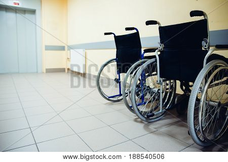 wheelchair is in the hospital near the elevator. Concept assistance in the movement.