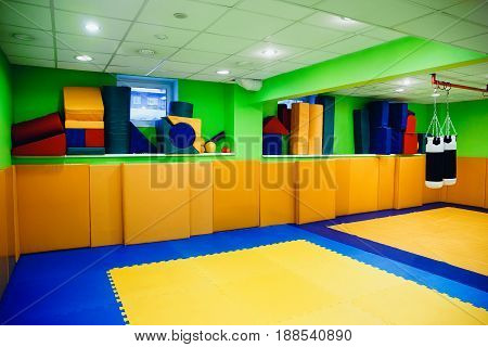 Sports hall for children, Concept game room with sports mats, pear for boxing, kickboxing and karate.