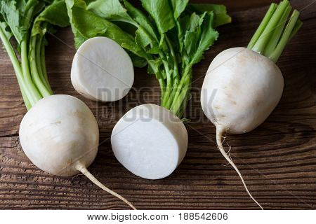 Tasty Fresh Crude White Round Japanese Radish With Green Stems And Leaves