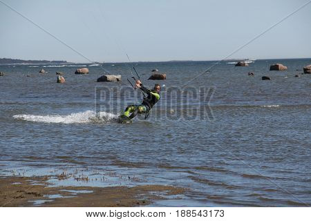 A spring kitesurfer in quite cold water