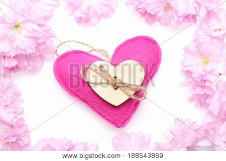 Heart Made Of Felt In Pink Colour And Wooden Heart