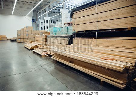 sawn wood. Shelf with structural materials on the shelves in the construction warehouse.