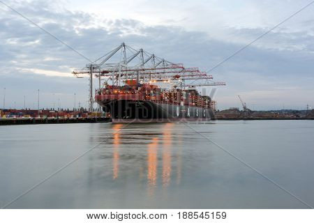Southampton, UK. 27th May 20017. A container ship is berthed at Southampton Docks on a warm summer's evening.