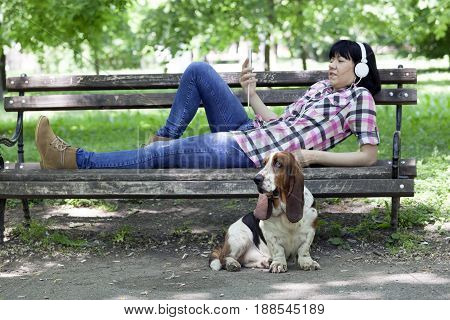 Woman With A Dog Enjoying The Beautiful Day In Nature.
