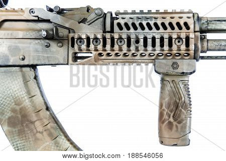 Close-up shot of Kalashnikov rifle fore-end with rails, automatic weapons isolated on white background. Gun fore end is painted desert camouflage