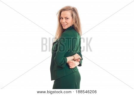 Cheerful young blonde business lady in green uniform smiling on camera isolated on white background
