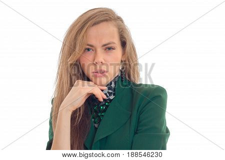Attractive blonde business lady in green uniform looking at the camera with tricky glance isolated on white background