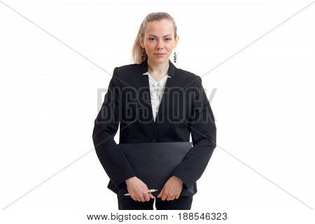 Cutie young business girl in uniform with tablet in hands looking at the camera isolated on white background