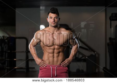 Bodybuilder Flexing Muscles