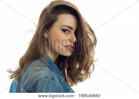 portrait close up of beautiful young brunette with make up in jeans clothes looking at the camera