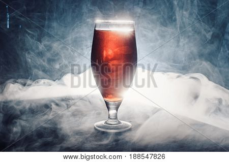 Filled Glasses On The Wooden Table With Some Kind Of Drink