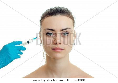 dermatologist injects a vaccine on the face of a young girl have close-up isolated on white background