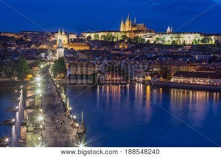 View of Charles Bridge Prague Castle and Vltava river in Prague Czech Republic during blue hour.