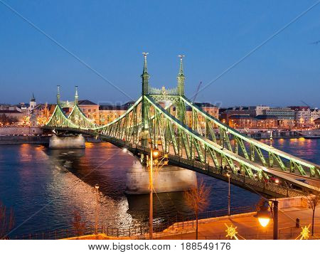 Illuminated Liberty Bridge and River Danube at night. Budapest, Hungary.