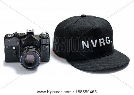 Black camera old and black cap on white background isolation