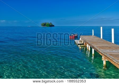 Pier leading to an island in the Caribbean