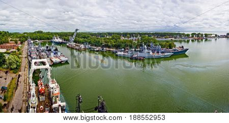 Baltiysk, Kaliningrad region, Russia - August 08, 2014: Aerial panorama view to Russian warships ships of Baltic fleet anchored in the bay