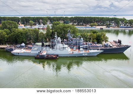 "Baltiysk, Kaliningrad region, Russia - August 08, 2014: Aerial view to Russian military ship ""Stereguschy"" of Baltic fleet anchored in the bay"