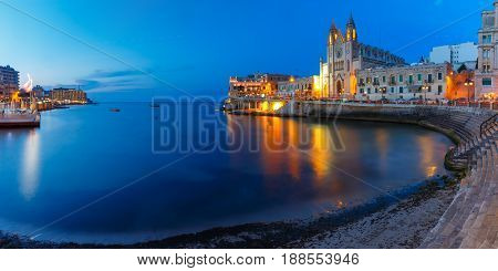 Balluta Bay and Neo-Gothic Church of Our Lady of Mount Carmel, Balluta parish church, during evening blue hour, Saint Julien, Malta